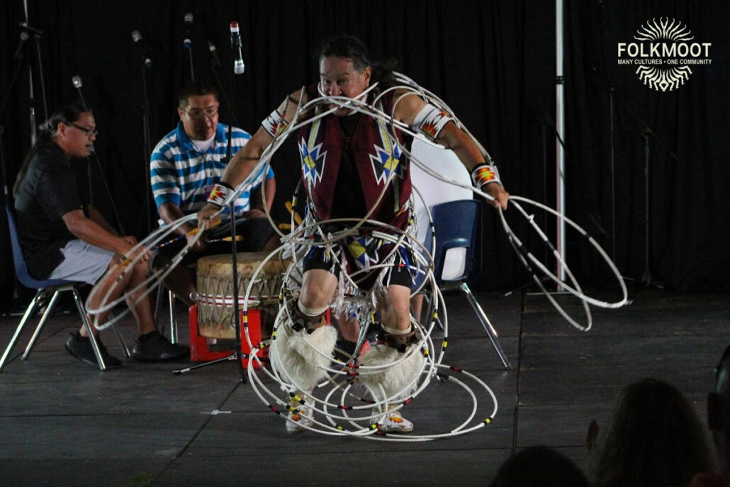 Eddie Swimmer of the Eastern Band of Cherokee Indians performs a hoop dance at the Folkmoot Gala Under the Stars, 2019.